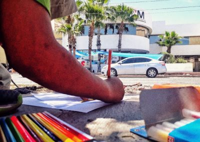 While we were waiting to have the first negotiations with the INM, we were drawing on the other side of the avenue. Protest at the INM. Elisa Colares (Nogales, Sonora, Mexico, 2018)
